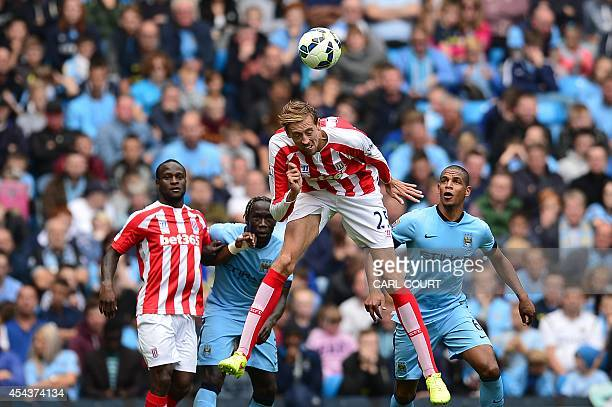 Stoke Citys English striker Peter Crouch heads the ball clear during the English Premier League football match between Manchester City and Stoke City...