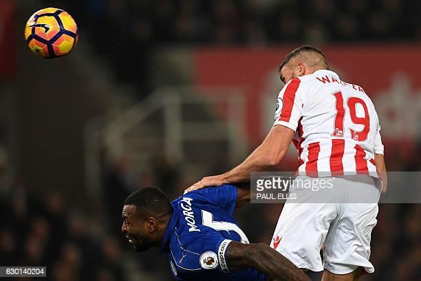 Stoke City's English-born Irish striker Jonathan Walters heads the ball towards goal but is denied by Leicester City's Danish goalkeeper Kasper...