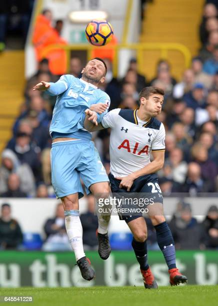 Stoke City's Englishborn Scottish defender Phil Bardsley jumps against Tottenham Hotspur's English midfielder Harry Winks during the English Premier...