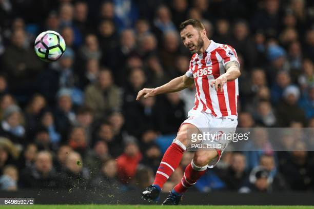 Stoke City's Englishborn Scottish defender Phil Bardsley passes the ball during the English Premier League football match between Manchester City and...