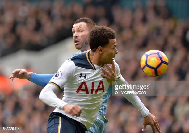 Stoke City's Englishborn Scottish defender Phil Bardsley tangles with Tottenham Hotspur's English midfielder Dele Alli during the English Premier...