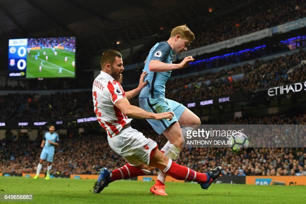 Stoke City's Englishborn Scottish defender Phil Bardsley vies with Manchester City's Belgian midfielder Kevin De Bruyne during the English Premier...