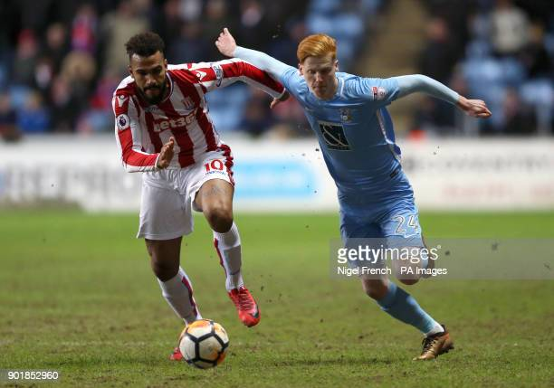 Stoke City's Eric Maxim ChoupoMoting and Coventry City's Ryan Haynes battle for the ball during the FA Cup third round match at the Ricoh Arena...