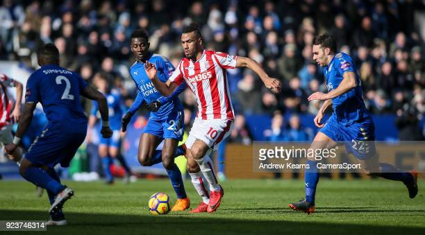 Stoke City's Eric Maxim ChoupoMoting breaks under pressure from Leicester City's Danny Simpson Wilfred Ndidi and Matthew James during the Premier...