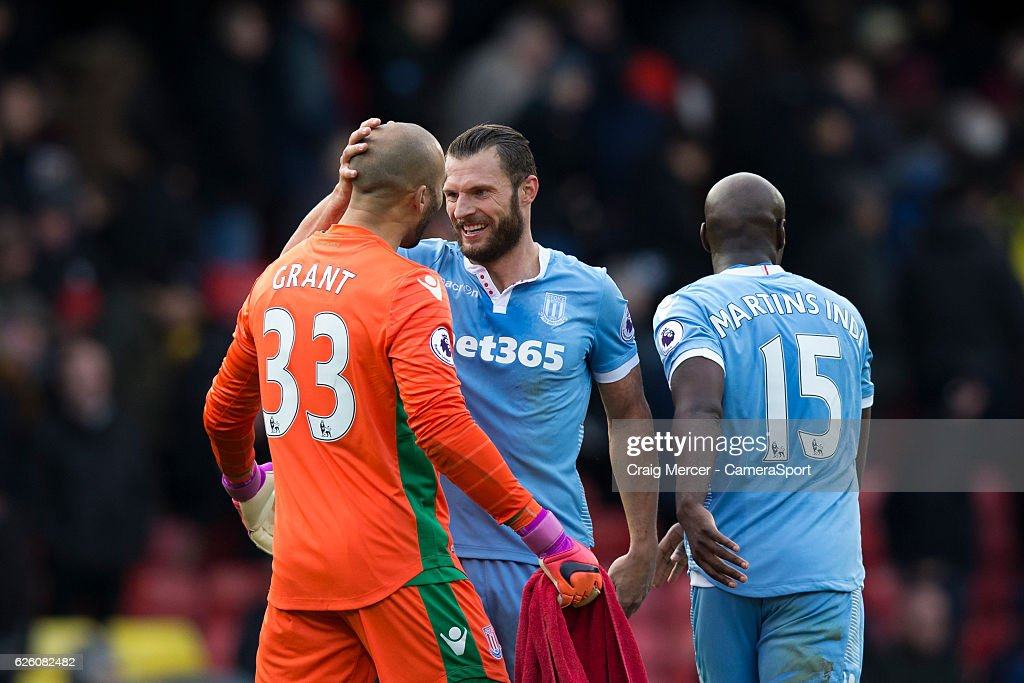 Stoke City's Erik Pieters (right) celebrates with team mate Lee Grant at full time of the Premier League match between Watford and Stoke City at Vicarage Road on November 27, 2016 in Watford, England.