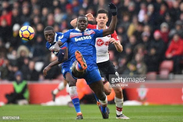 Stoke City's French defender Kurt Zouma clears under pressure from Southampton's Argentinian striker Guido Carrillo during the English Premier League...