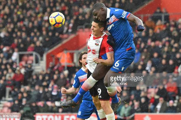 Stoke City's French defender Kurt Zouma vies with Southampton's Argentinian striker Guido Carrillo during the English Premier League football match...