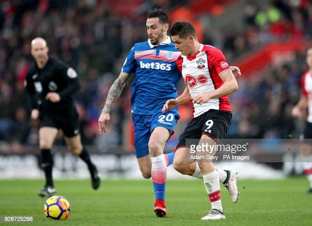 Stoke City's Geoff Cameron and Southampton's Guido Carrillo battle for the ball during the Premier League match at St Mary's Stadium Southampton