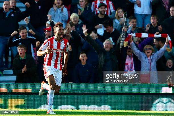 Stoke City's German midfielder Eric Maxim ChoupoMoting celebrates scoring his team's first goal during the English Premier League football match...