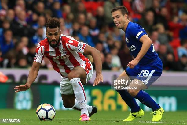Stoke City's German midfielder Eric Maxim ChoupoMoting vies with Chelsea's Spanish defender Cesar Azpilicueta during the English Premier League...