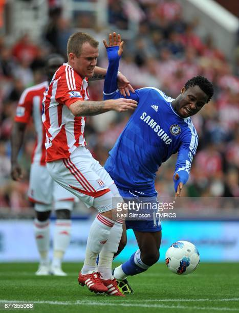 Stoke City's Glenn Whelan and Chelsea's Mikel battle for the ball