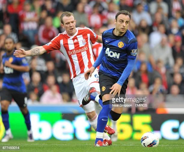 Stoke City's Glenn Whelan and Manchester United's Dimitar Berbatov battle for the ball