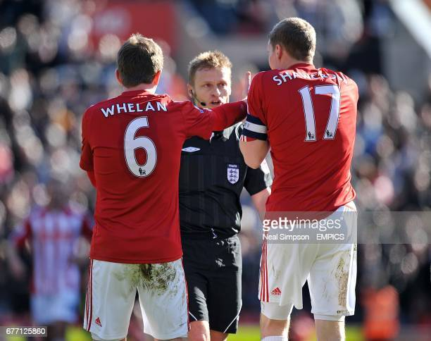 Stoke City's Glenn Whelan and Ryan Shawcross protest to match referee Mike Jones after West Ham United's opening goal