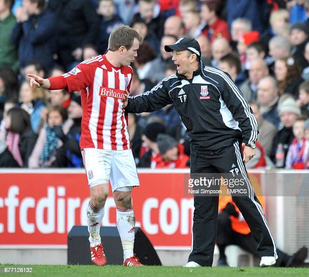 Stoke City's Glenn Whelan receives instructions from his manager Tony Pulis