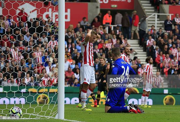 Stoke City's Irish goalkeeper Shay Given reacts after Tottenham Hotspur's South Korean striker Son HeungMin scored his team's first goal during the...
