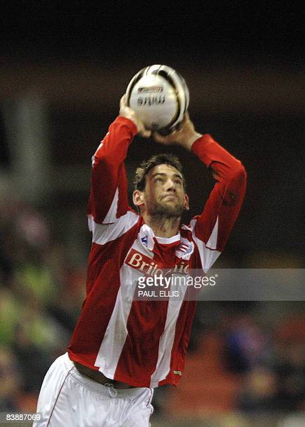 Stoke City's Irish midfielder Rory Delap takes a throw-in during their English League Cup quarter final football match against Derby County at The...