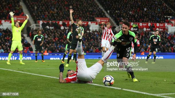 Stoke City's Jese unsuccessfully appeals for a penalty as he is tackled by Bournemouth's Adam Smith during the Premier League match between Stoke...