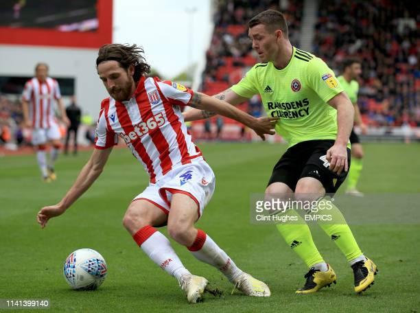 Stoke City's Joe Allen and Sheffield United's John Fleck battle for the ball Stoke City v Sheffield United Sky Bet Championship bet365 Stadium