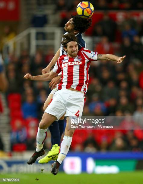 Stoke City's Joe Allen and West Bromwich Albion's Ahmed Hegazy battle for the ball during the Premier League match at the Bet365 Stadium Stoke