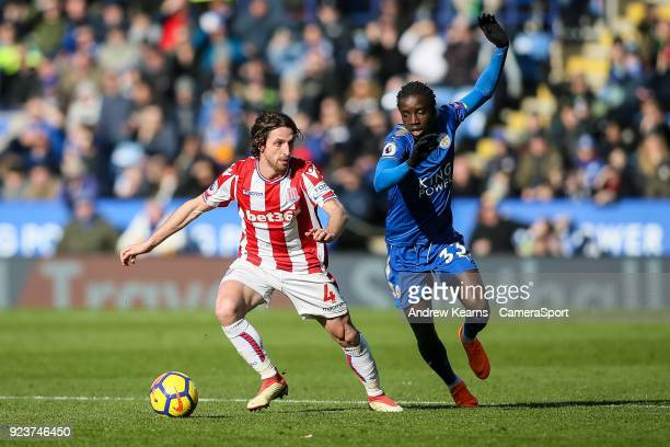 Stoke City's Joe Allen breaks away from Leicester City's Fousseni Diabate during the Premier League match between Leicester City and Stoke City at...