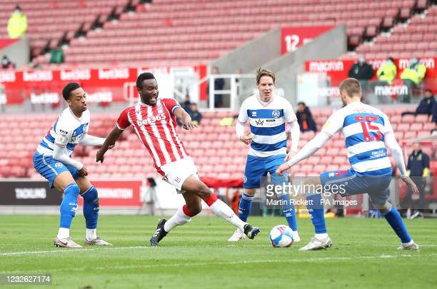 Stoke City's John Obi Mikel battles for the ball with Queens Park Rangers' Chris Willock and Sam Field during the Sky Bet Championship match at the...