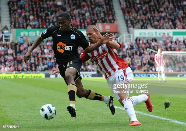 Stoke City's Jonathan Walters and Wigan Athletic's Maynor Figueroa battle for the ball