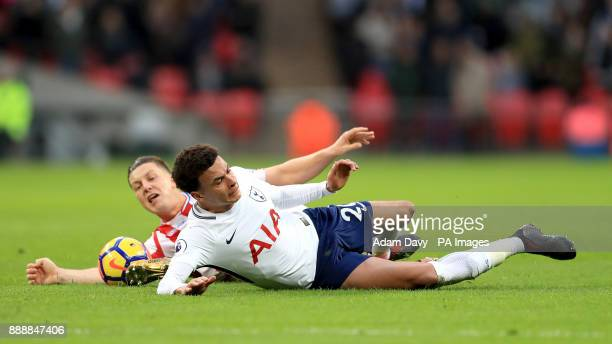 Stoke City's Kevin Wimmer and Tottenham Hotspur's Dele Alli on the ground after battling for the ball during the Premier League match at Wembley...