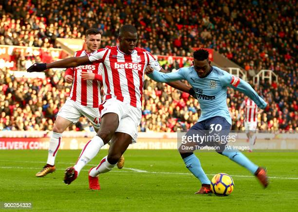Stoke City's Kurt Zouma and Newcastle United's Christian Atsu battle for the ball during the Premier League match at the bet365 Stadium Stoke