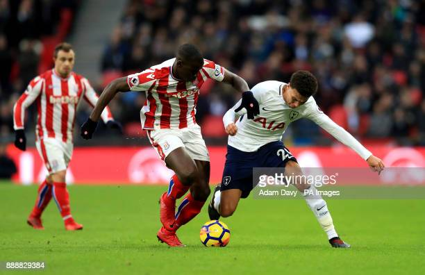 Stoke City's Kurt Zouma and Tottenham Hotspur's Dele Alli battle for the ball during the Premier League match at Wembley Stadium London