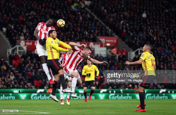 Stoke City's Kurt Zouma and Watford's Troy Deeney battle for the ball in the air during the Premier League match at the bet365 Stadium Stoke