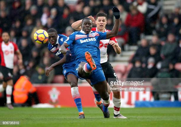 Stoke City's Kurt Zouma Bruno Martins Indi and Southampton's Guido Carrillo battle for the ball during the Premier League match at St Mary's Stadium...