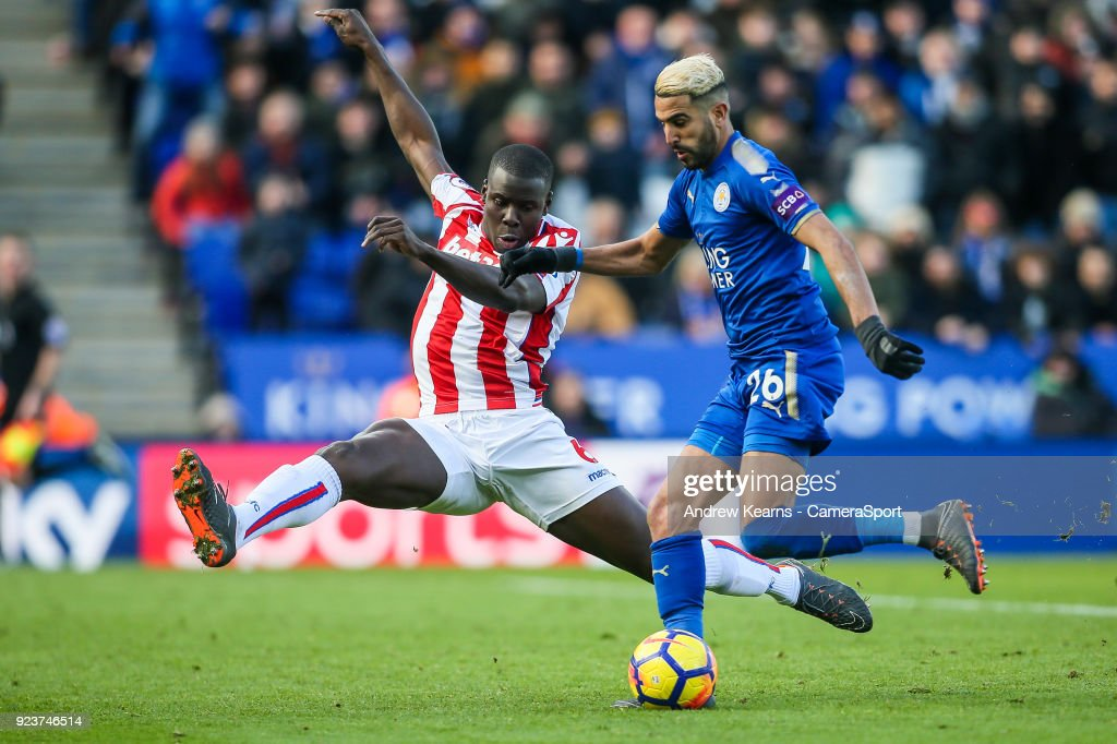 Stoke City's Kurt Zouma tries to block a shot from Leicester City's Riyad Mahrez during the Premier League match between Leicester City and Stoke City at The King Power Stadium on February 24, 2018 in Leicester, England.