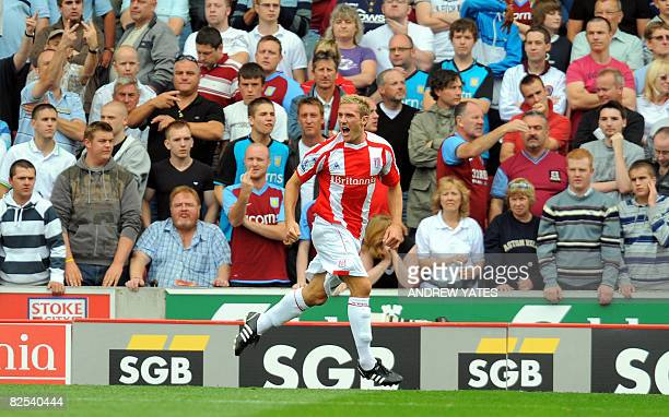 Stoke City's Liam Lawrence celebrates after scoring a penalty during the Premier league football match against Aston Villa at The Britannia Stadium...