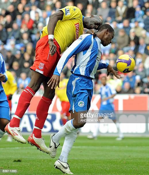 Stoke City's Malian forward Mamady Sidibe vies with Wigan Athletic's Honduran defender Maynor Figueroa during the English Premier league football...