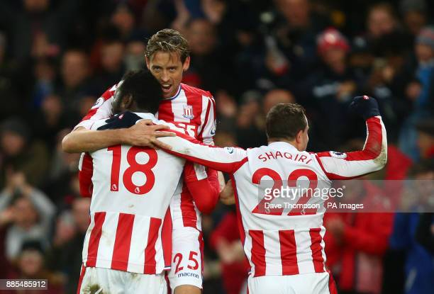Stoke City's Mame Biram Diouf celebrates scoring his side's first goal of the game with Stoke City's Peter Crouch and Stoke City's Xherdan Shaqiri...