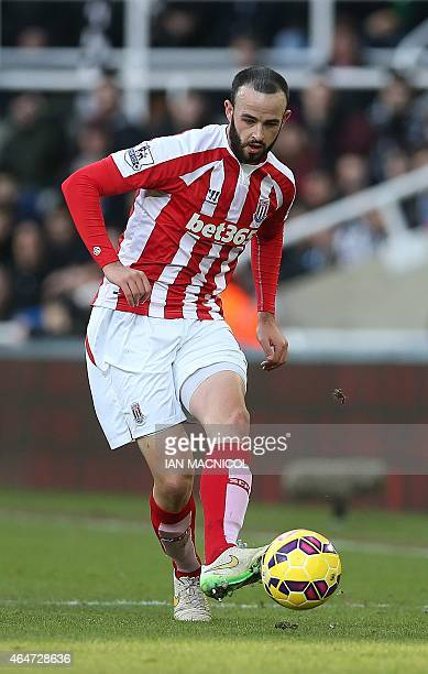 Stoke City's Northern Irishborn Irish defender Marc Wilson plays the ball during the English Premier League football match between Newcastle and...