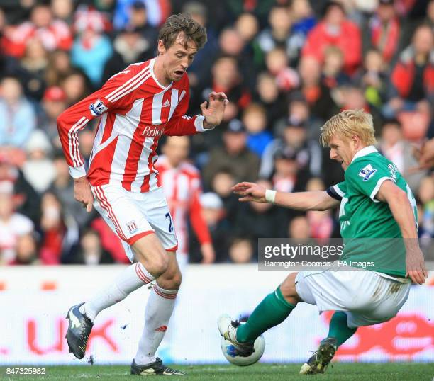 Stoke City's Peter Crouch and Norwich City's Zak Whitbread battle for the ball during the Barclays Premier League match at the Britannia Stadium...