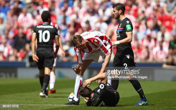 Stoke City's Peter Crouch exchanges words with Crystal Palace's Yohan Cabaye during the Premier League match at the bet365 Stadium Stoke