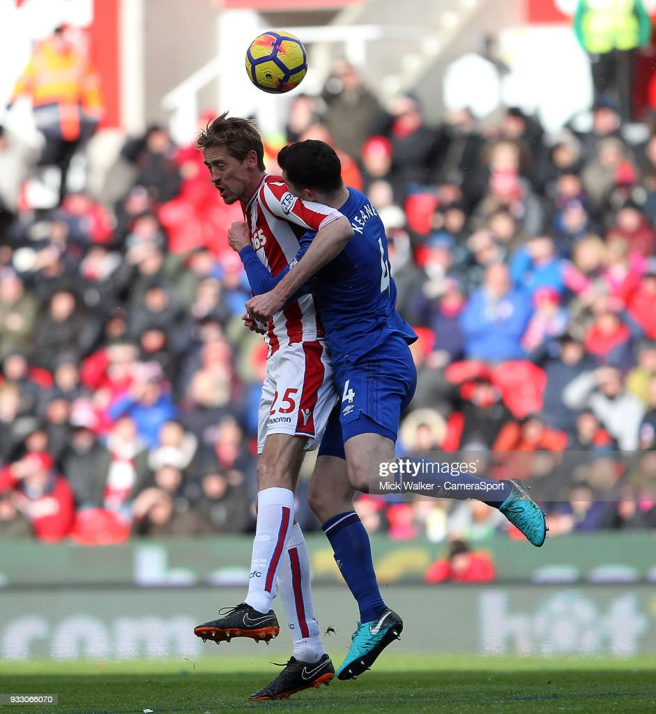Stoke City's Peter Crouch in action with Everton's Michael Keane during the Premier League match between Stoke City and Everton at Bet365 Stadium on March 17, 2018 in Stoke on Trent, England.