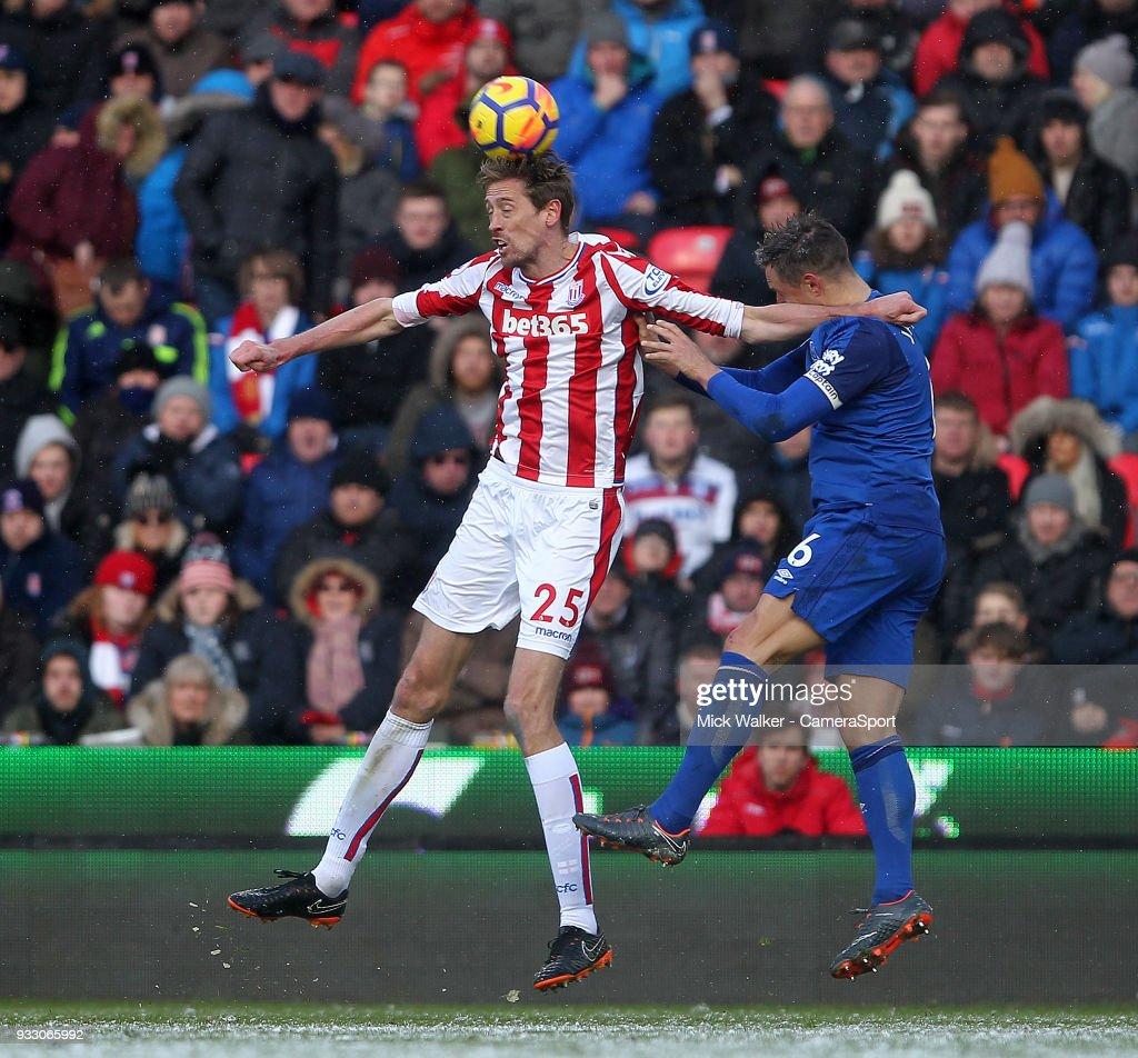 Stoke City's Peter Crouch in action with Everton's Phil Jagielka during the Premier League match between Stoke City and Everton at Bet365 Stadium on March 17, 2018 in Stoke on Trent, England.
