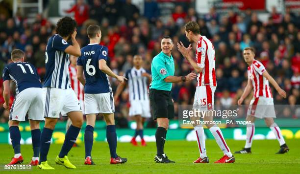 Stoke City's Peter Crouch speaks with referee Neil Swarbrick after a challenge on West Bromwich Albion's Ahmed Hegazy during the Premier League match...