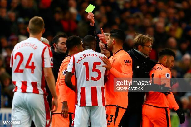 Stoke City's Portugueseborn Dutch defender Bruno Martins Indi and Liverpool's English midfielder Alex OxladeChamberlain are booked during the English...