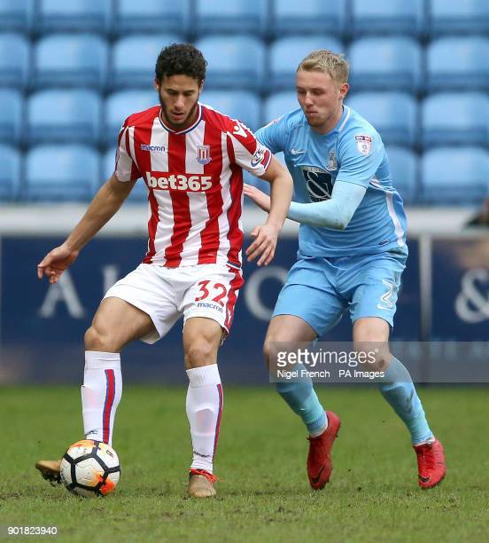 Stoke City's Ramadan Sobhi and Coventry City's Jack Grimmer battle for the ball during the FA Cup third round match at the Ricoh Arena Coventry