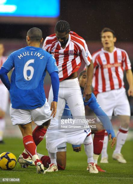 Stoke City's Salif Diao's shorts fall down after a tangle with Portsmouth's KevinPrince Boateng