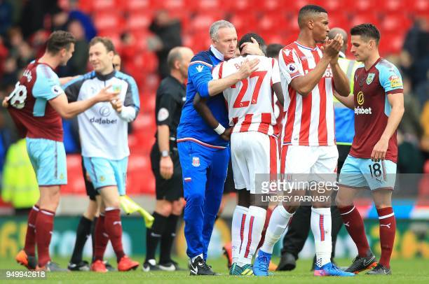 Stoke City's Scottish manager Paul Lambert congratulates Stoke City's Senegalese defender Badou Ndiaye following the English Premier League football...