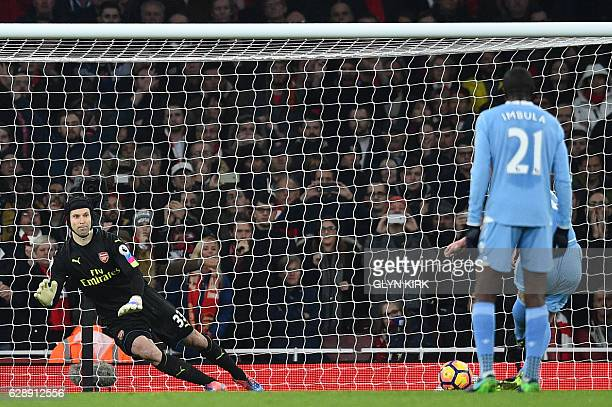 Stoke City's Scottish midfielder Charlie Adam scores from the penalty spot past Arsenal's Czech goalkeeper Petr Cech during the English Premier...