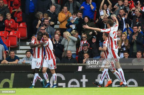Stoke City's Senegalese defender Badou Ndiaye celebrates scoring the opening goal during the English Premier League football match between Stoke City...