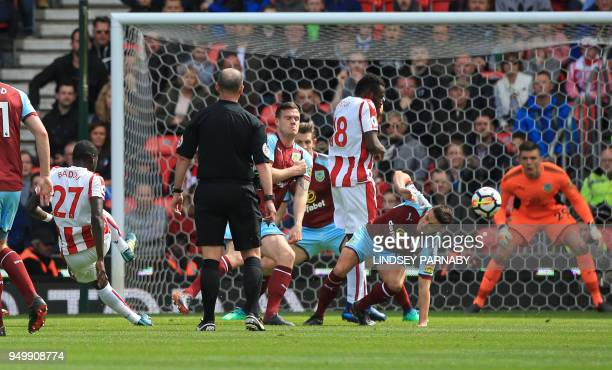 Stoke City's Senegalese defender Badou Ndiaye scores the opening goal during the English Premier League football match between Stoke City and Burnley...
