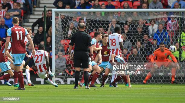 Stoke City's Senegalese defender Badou Ndiaye shoots past Burnley's English goalkeeper Nick Pope to score the opening goal during the English Premier...