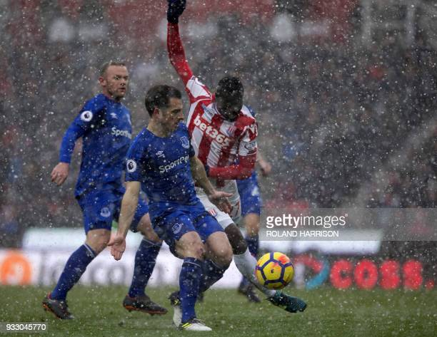 Stoke City's Senegalese defender Badou Ndiaye takes a shot during the English Premier League football match between Stoke City and Everton at the...